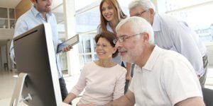 elderly group using computer