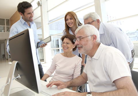 elderly group using computer
