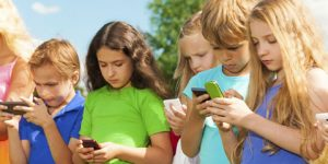 group of children on mobile devices