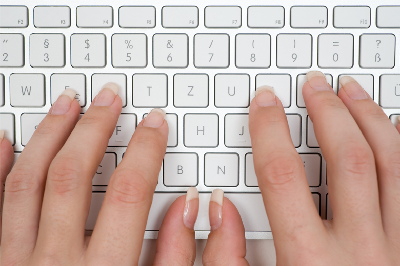 women's hands over keyboard