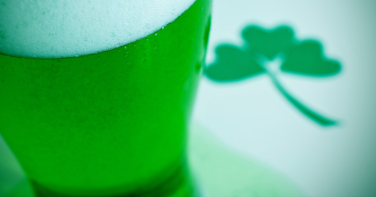 Close up of green beer and shamrock