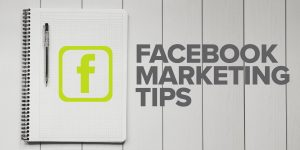 Facebook Marketing Tips with notebook and pen
