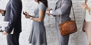 Line of office professionals on mobile devices